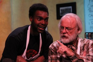Sesugh Solomon Tor-Agbidye as Franco Wicks and Charlie Ferrie as Arthur Przybyszewski in OpenStage Theatre's production of Superior Donuts by Tracy Letts. Photo by Joe Hovorka